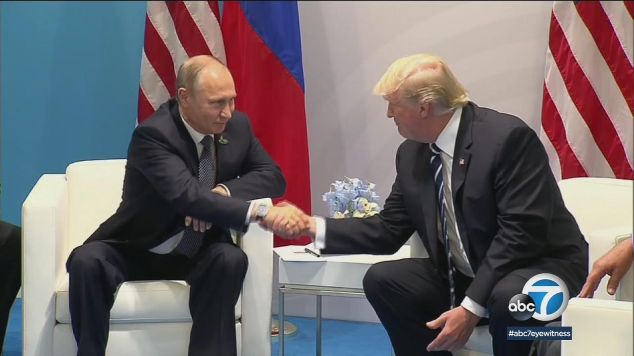 Russian President Vladmir Putin and President Donald Trump shake hands during a previous international meeting.