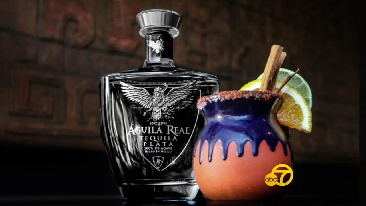 A bottle of Aguila Real Tequila is shown.