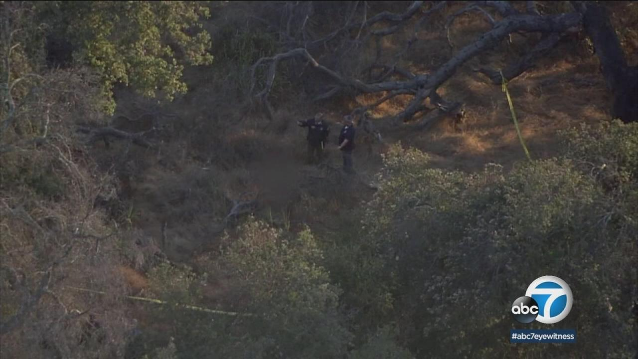 Authorities scour the area for clues after a womans body was found in an area not far from where a hiker went missing on Sunday.