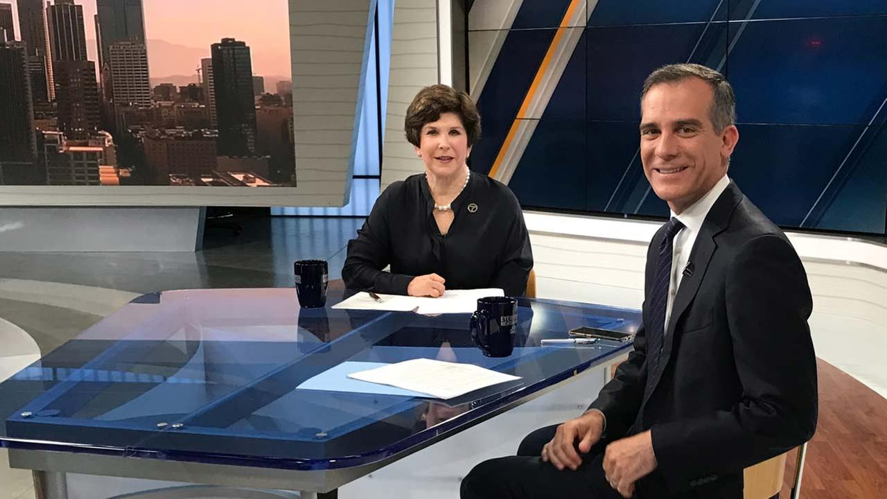 Eyewitness Newsmakers host Adrienne Alpert and L.A. Mayor Eric Garcetti pose for a photo.