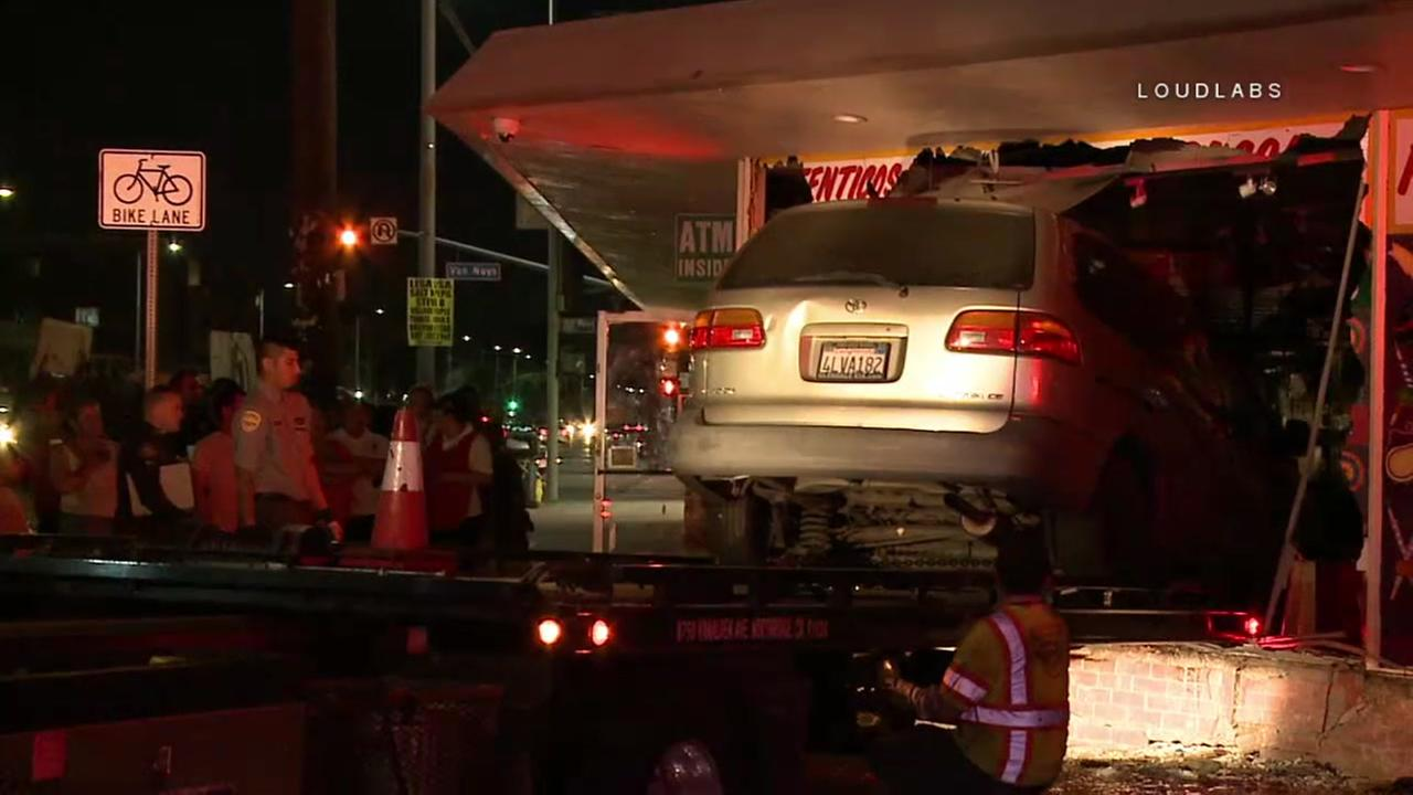 A multi-vehicle collision sent a minivan hurtling through the front window of a taqueria in Panorama City, police said.