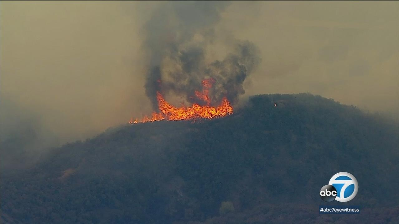 Firefighters continued to make progress against a 250-acre brush fire in Corona while some evacuation orders remained in place.