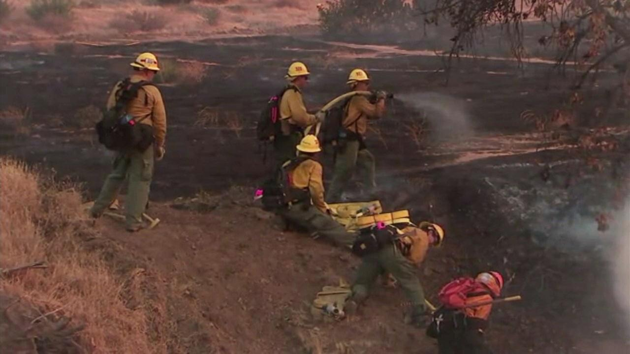 Firefighters seen getting a handle on the Skyline Fire near Corona on Friday, July 20, 2018.