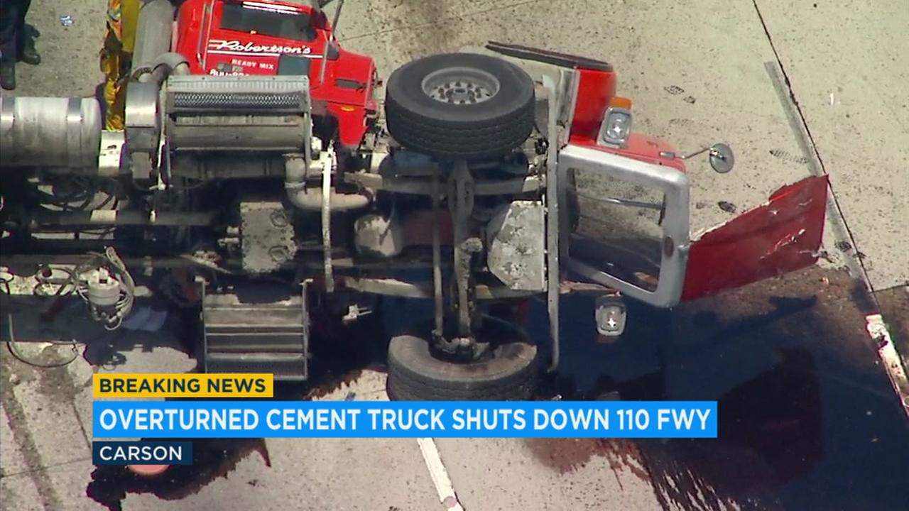 The big rig was on its side, blocking at least three lanes as liquid spilled onto the freeway.