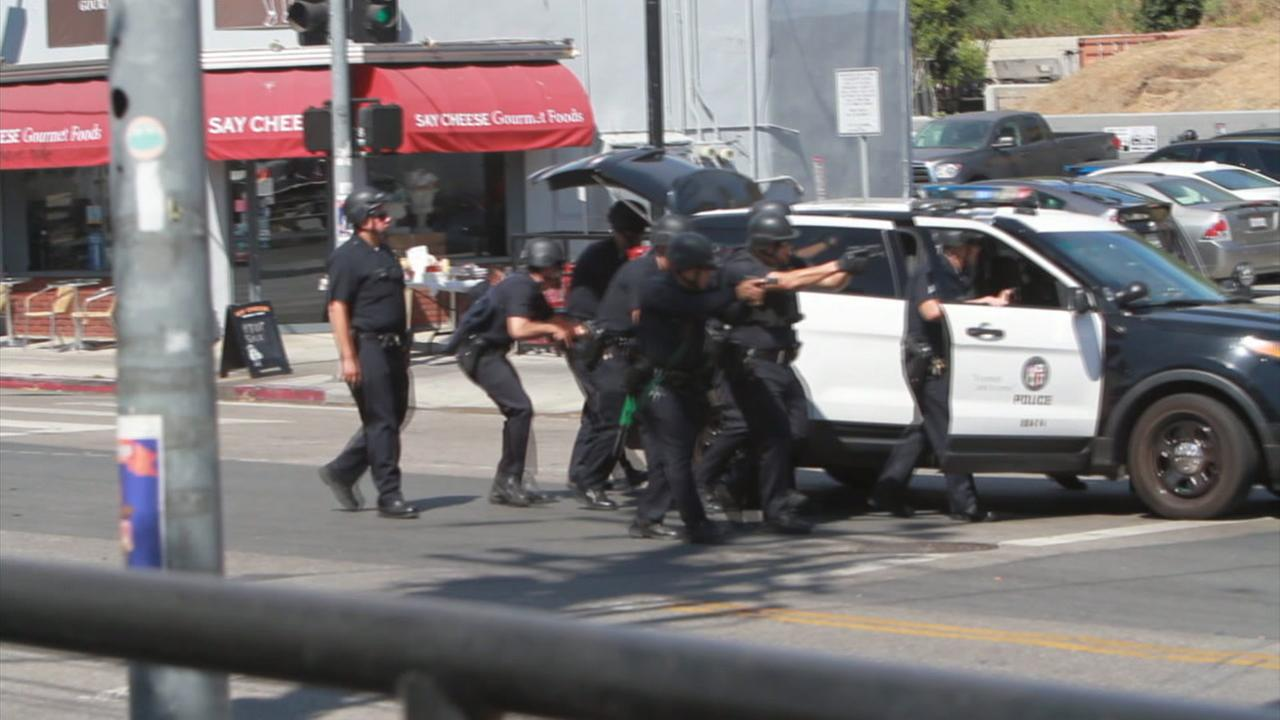 Several LAPD officers moved forward during a tense and deadly hostage situation at a Trader Joes in Silver Lake on Saturday, July 21, 2018.
