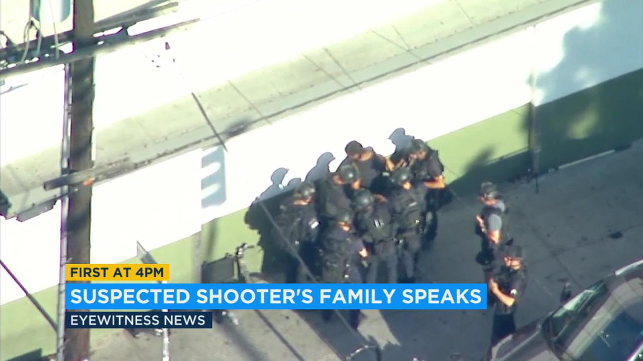 A SWAT team gathers outside the Trader Joes in Silver Lake where a gunman had taken customers hostage following a police chase.