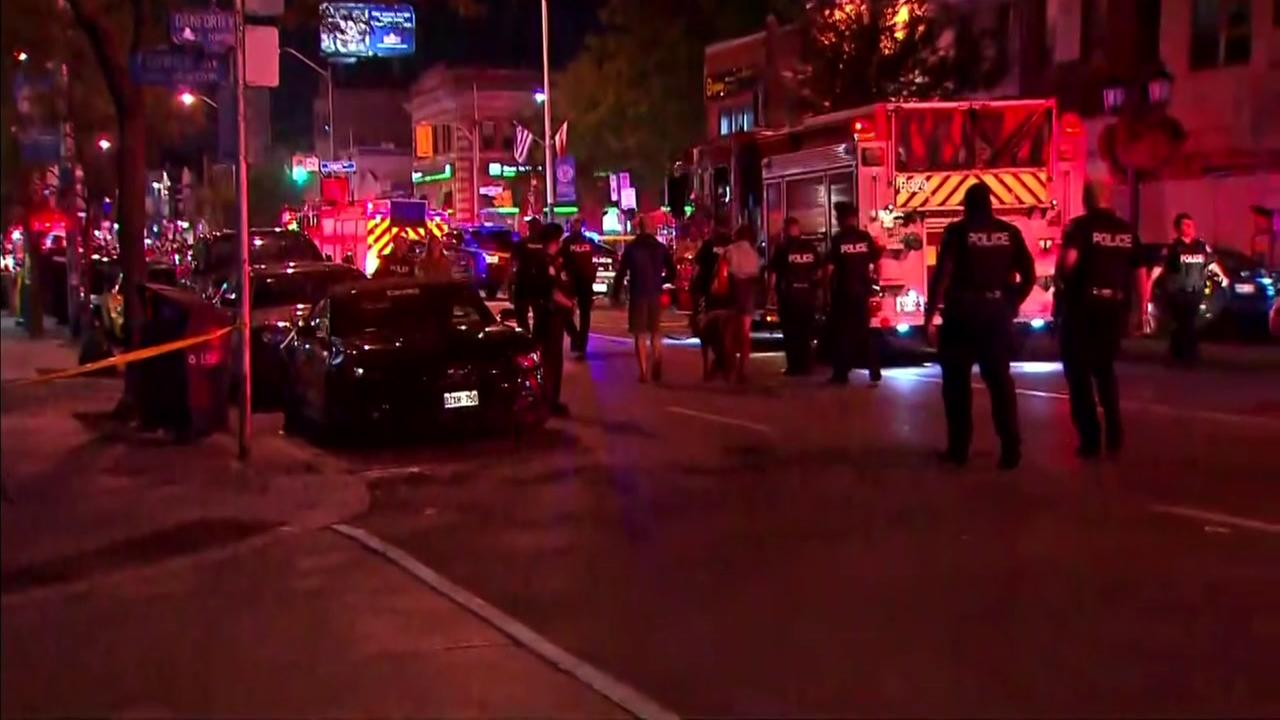 Police and paramedics respond to a mass shooting in Toronto on Sunday, July 22, 2018.