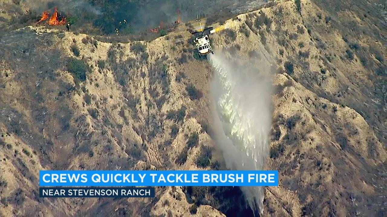 Firefighters quickly tackled a brush fire in Santa Clarita Monday that burned through 90 acres in the midst of excessive heat warnings.