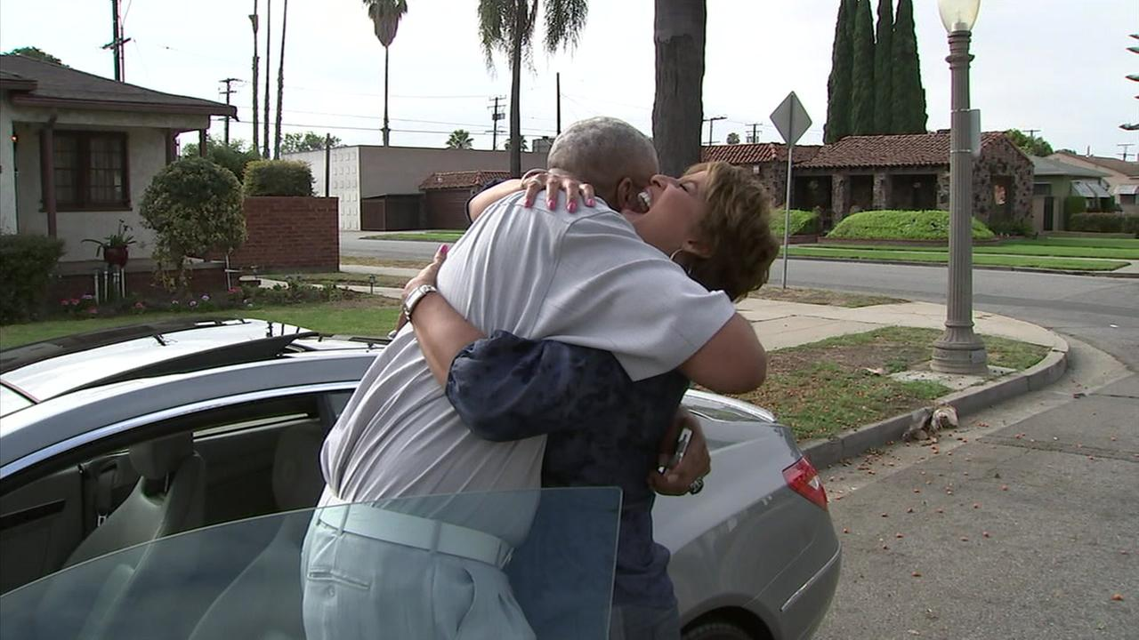 Leslie Sykes hugs a friend who she grew up with in Compton.