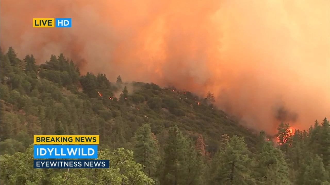 A brush fire was spreading over hundreds of acres in the San Bernardino National Forest Wednesday, prompting evacuations in Idyllwild.