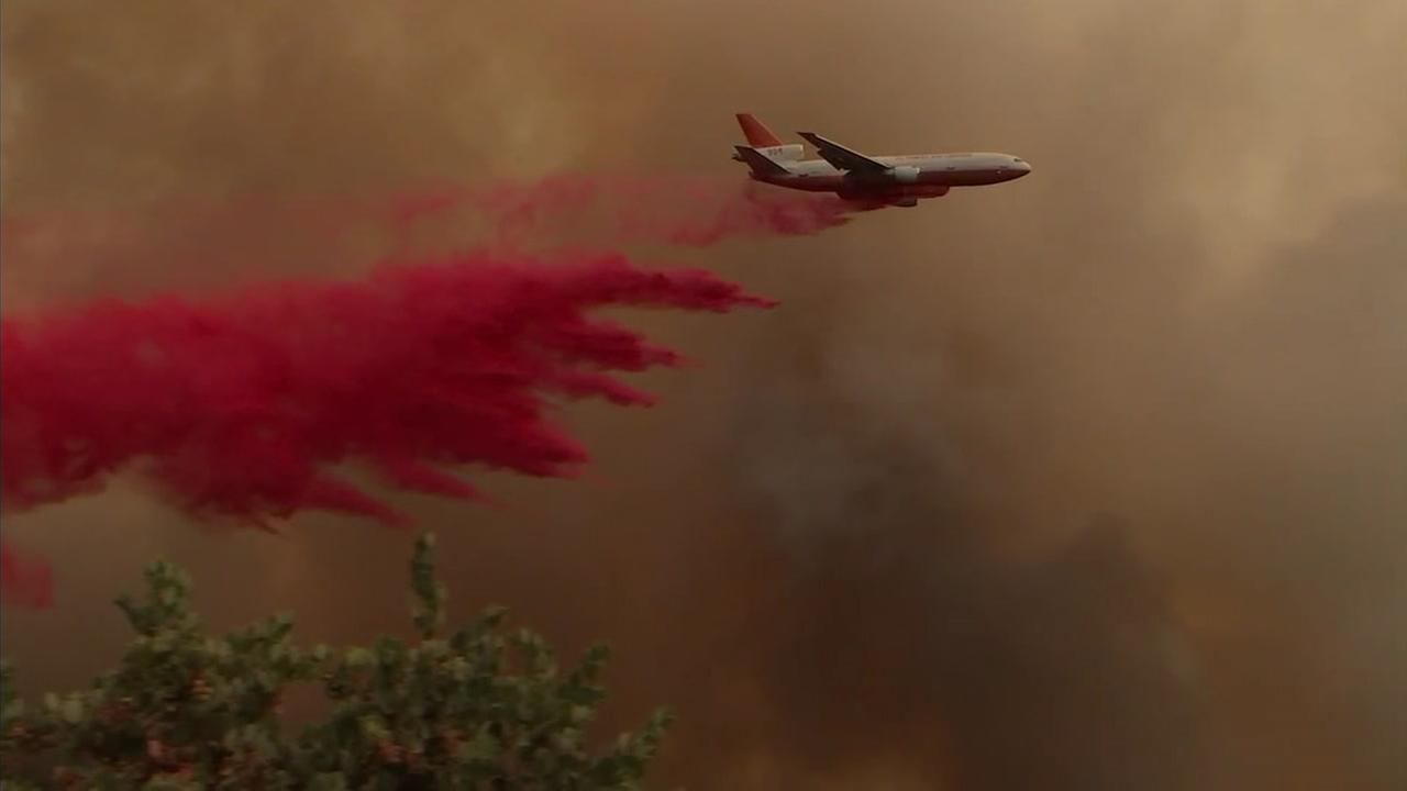 An air tanker drops phoscheck on areas about to be burned by the Cranston Fire burning in Idyllwild on Thursday, July 26, 2018.
