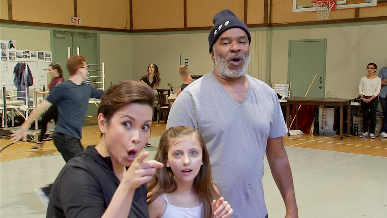 The cast of Annie is rehearsing for their live performance at the Hollywood Bowl.
