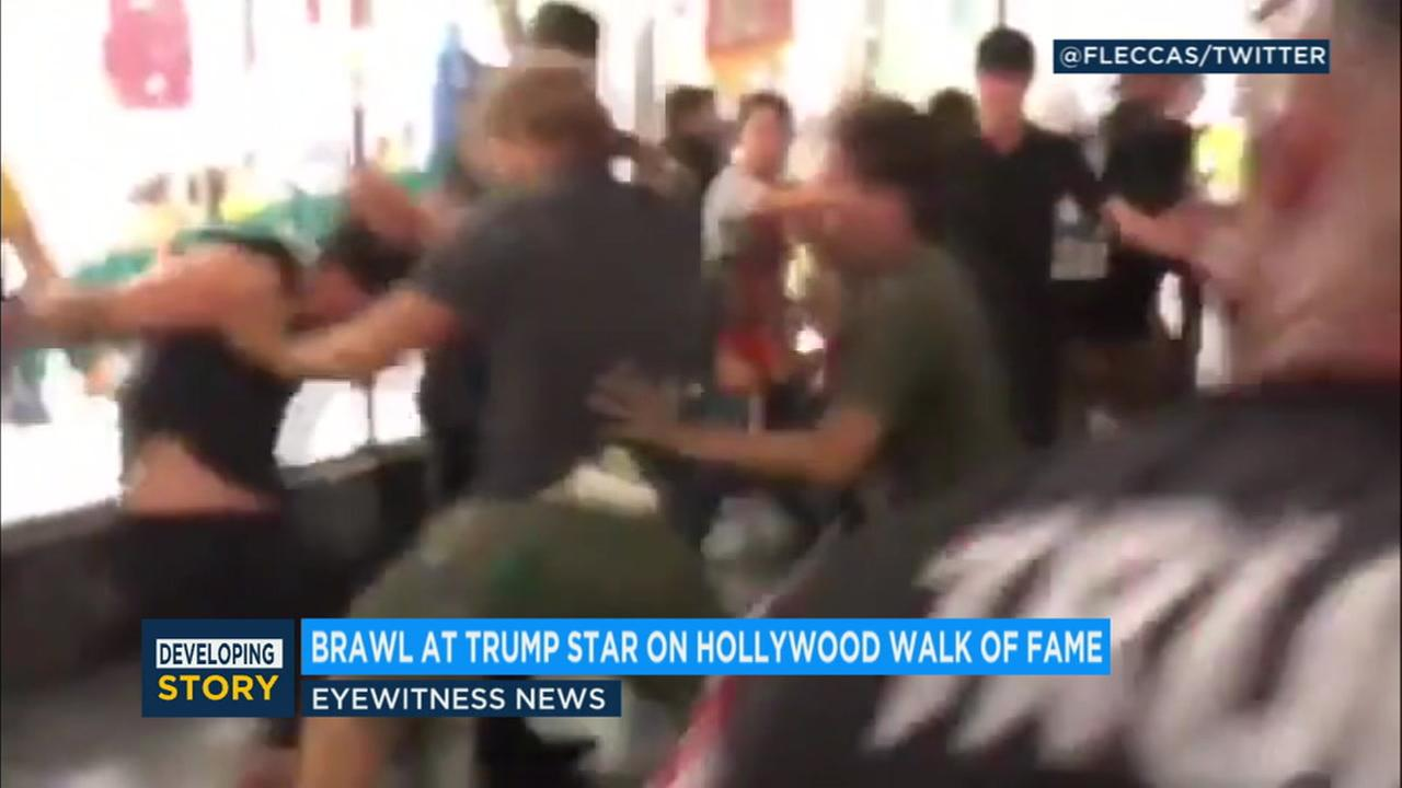 Video captured a fight that broke out at Donald Trumps star on the Hollywood Walk of Fame Thursday night, and officers are looking for two men involved.