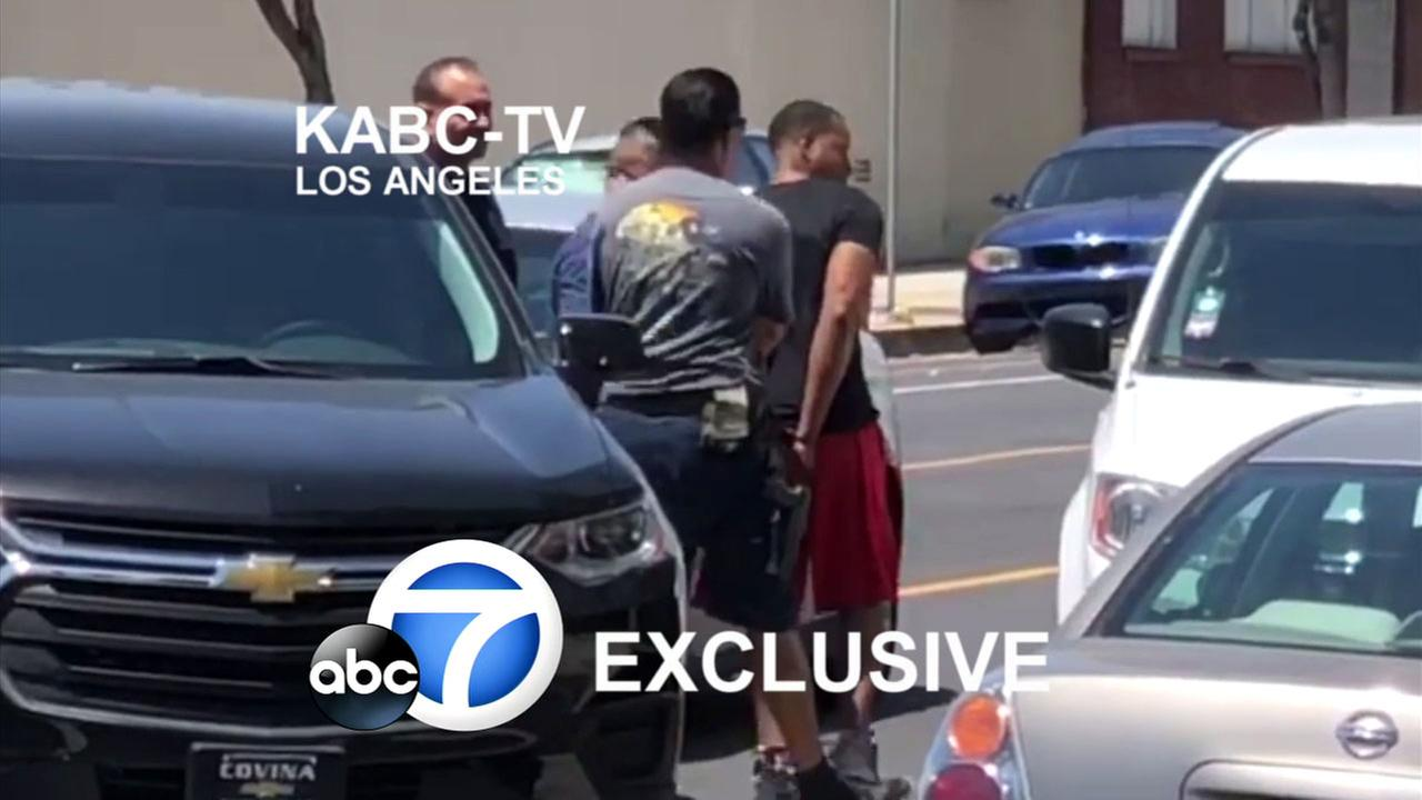 Exclusive video footage shows a New York City murder suspect being placed into a law enforcement vehicle after being arrested in North Hollywood.