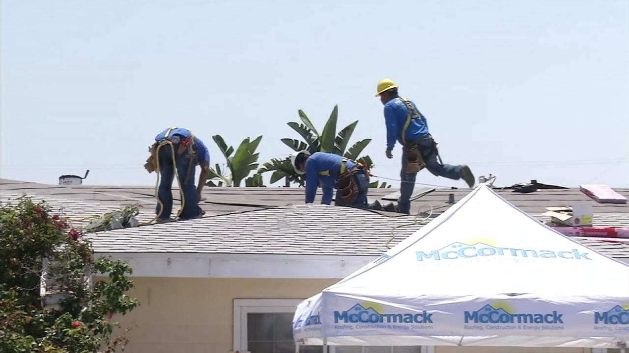 Construction workers with the Owens Corning Roof Deployment Project moved quickly to install a new roof at Robert and Patricia Souzas home in Costa Mesa.