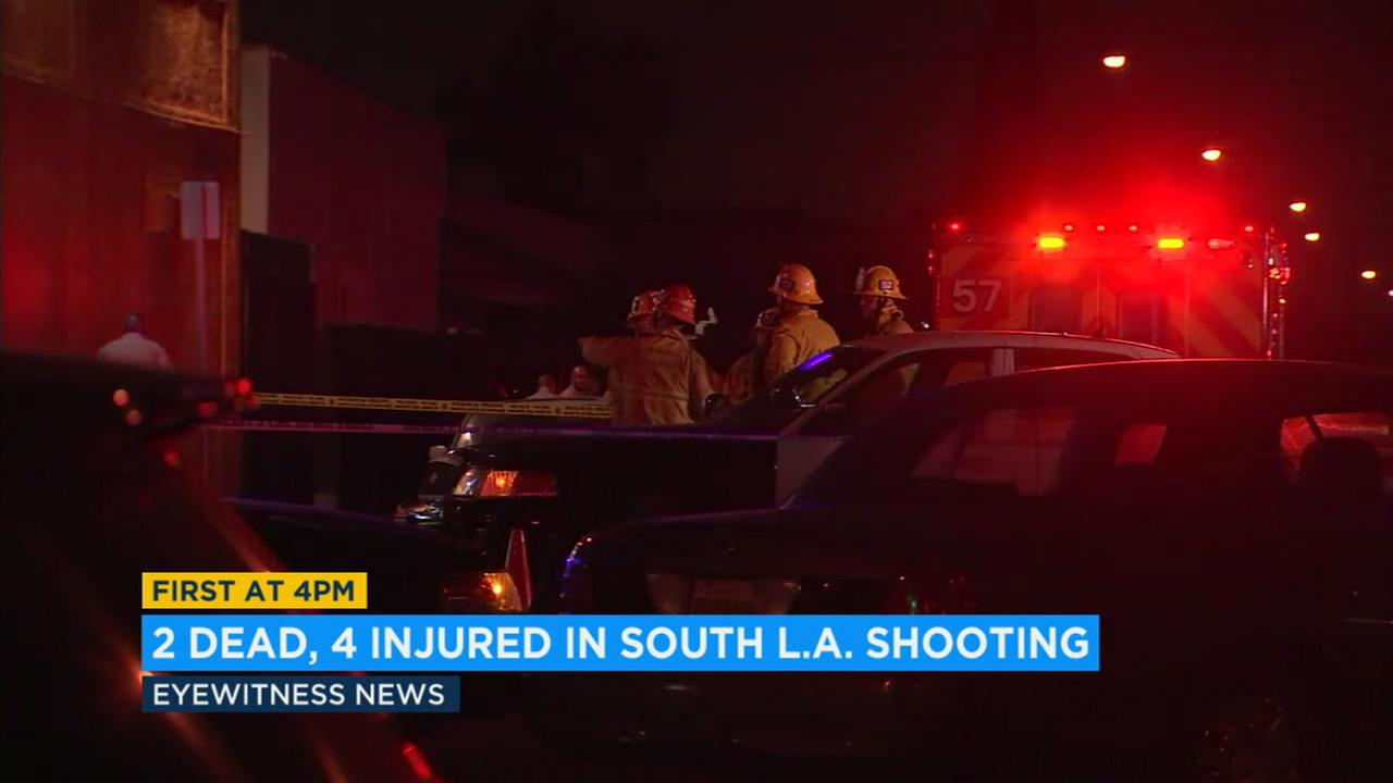 Two people are dead and several others are wounded following a drive-by shooting outside of a liquor store in South Los Angeles Saturday night.