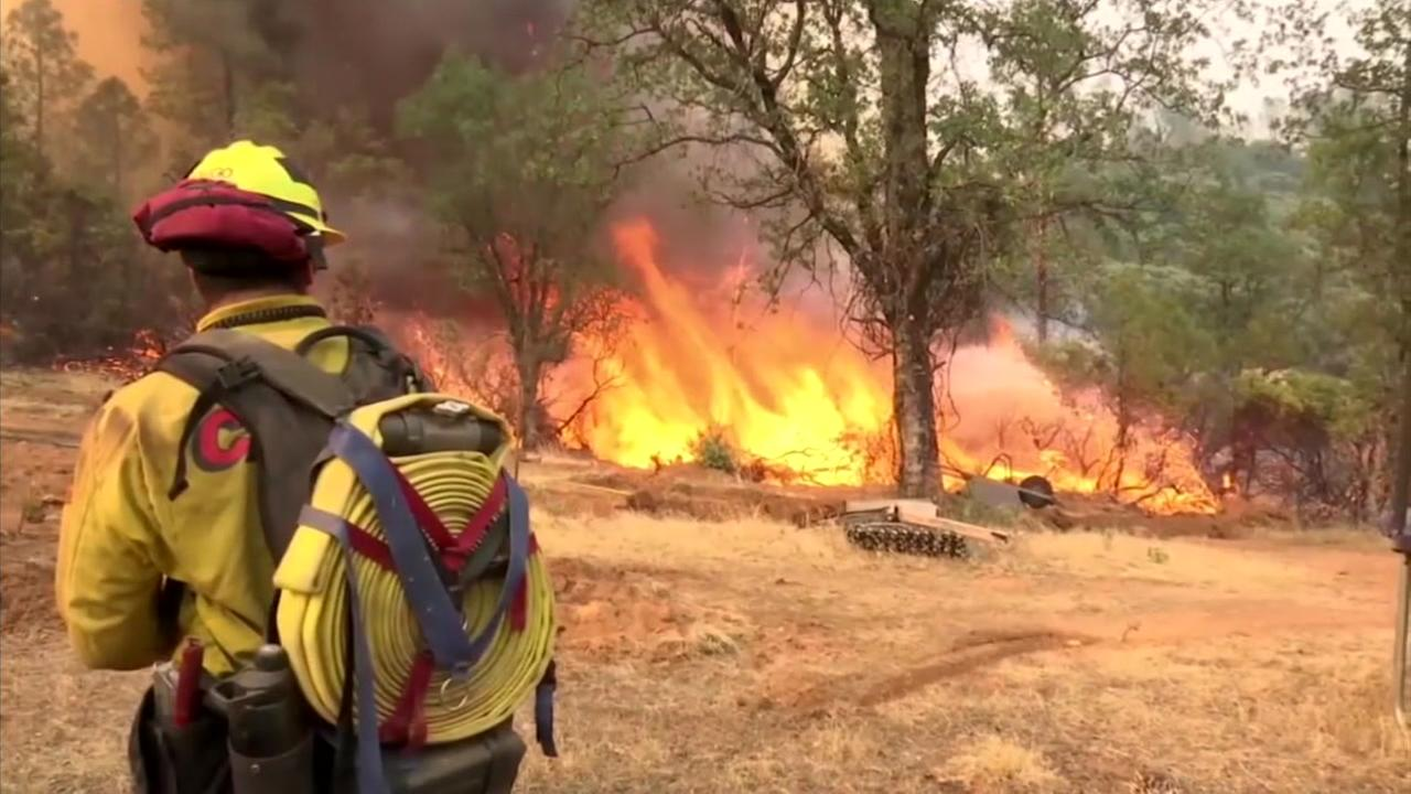A firefighter battles the intense flames from the Carr Fire.