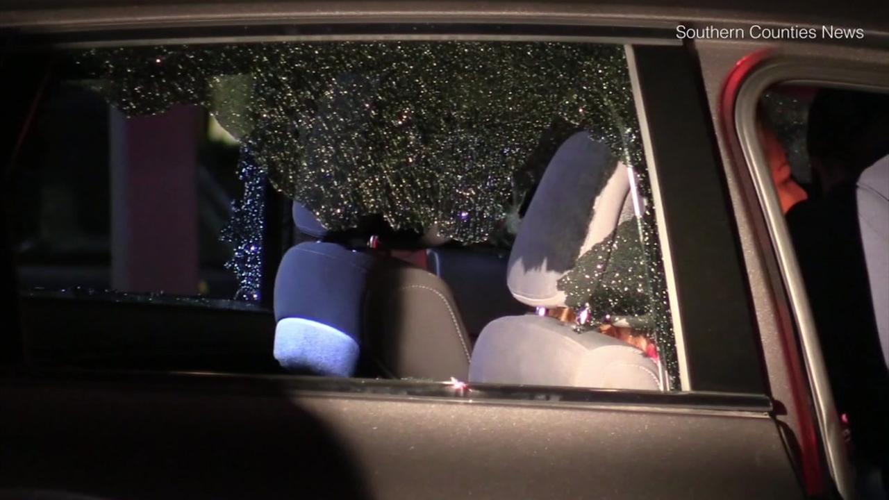 A shattered window on a car belonging to a woman who was shot while driving in Cerritos early Wednesday, Aug. 1, 2018.