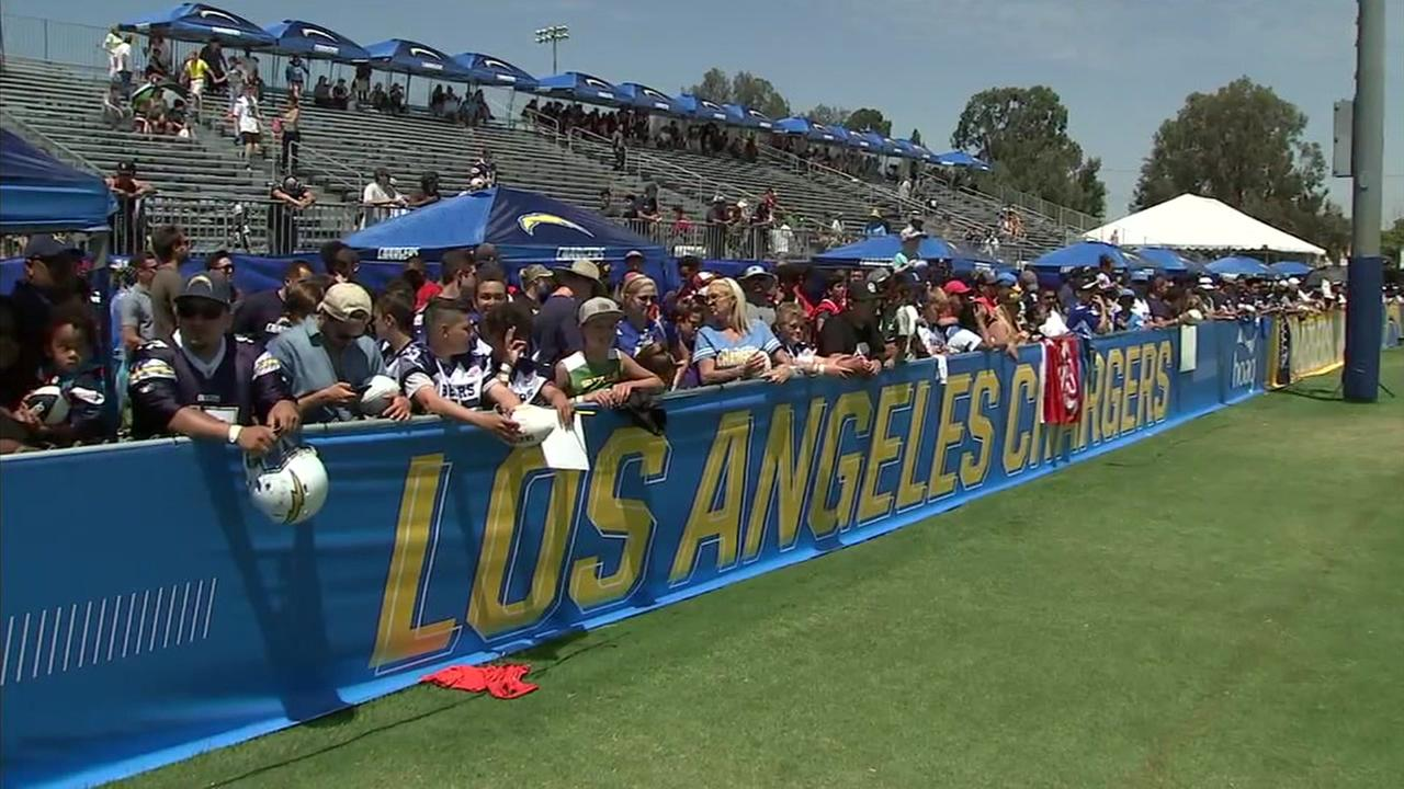Los Angeles Chargers fans are shown waiting to meet the team during their Costa Mesa practice.
