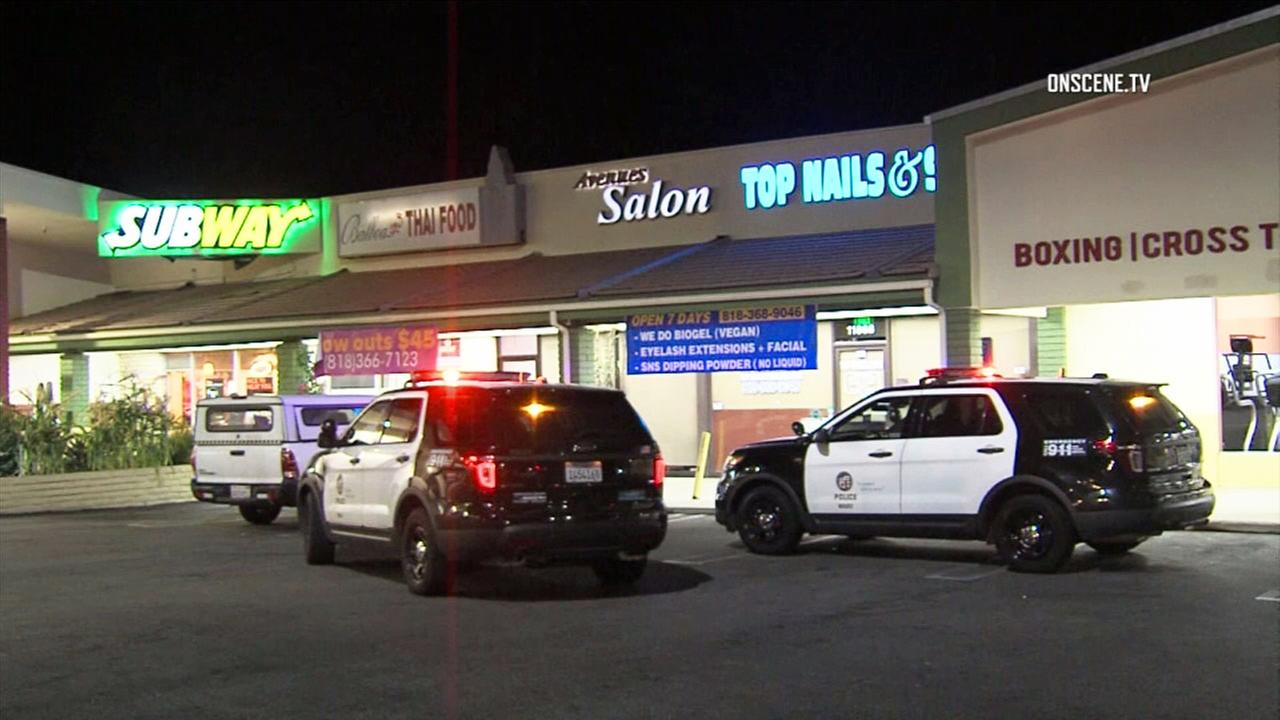 Patrol vehicles are seen outside of a Subway restaurant in Porter Ranch after it was robbed on Thursday, Aug. 2, 2018.