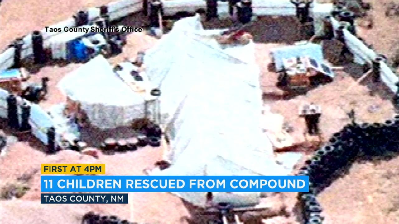 Deputies arrested five adults on child abuse charges after discovering 11 children inside a filthy makeshift compound in the tiny community of Amalia littered with odorous trash and lacking clean water.