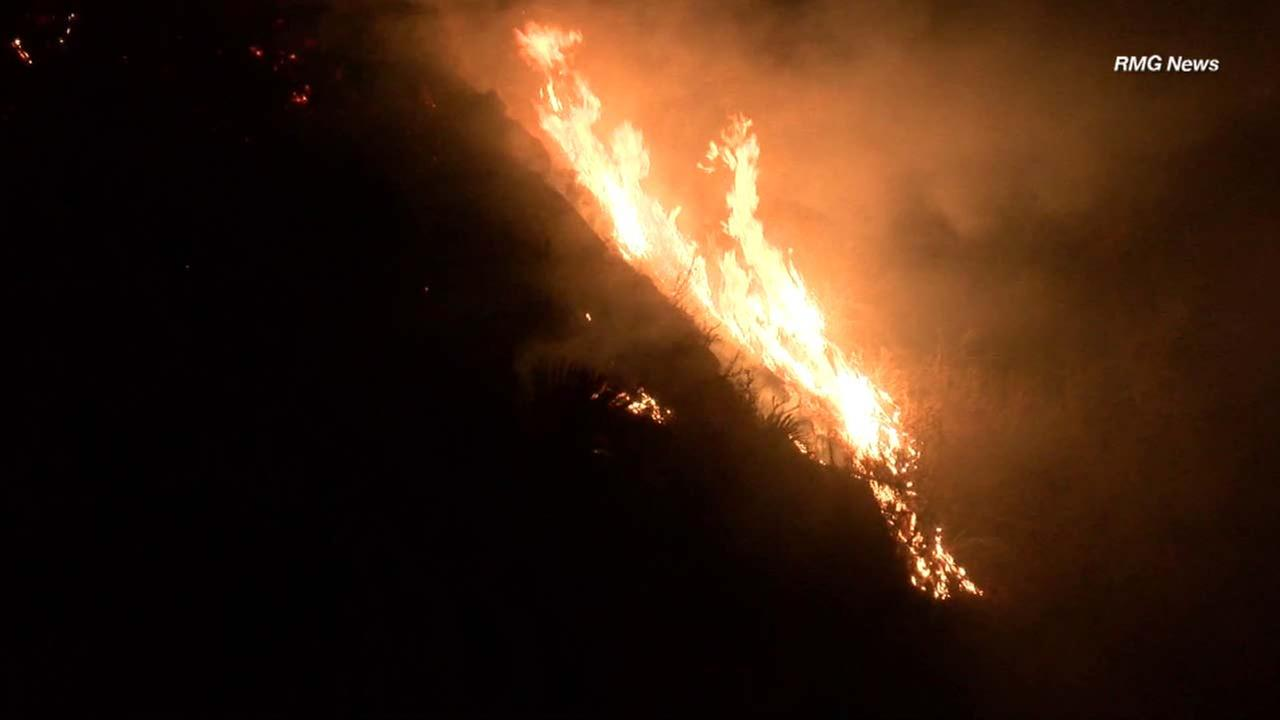 A small brush fire erupted near Morris Dam in the Angeles National Forest on Tuesday, Aug. 7, 2018.