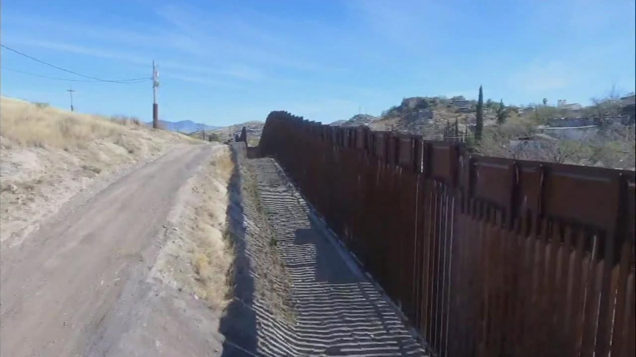 This undated file photo shows a portion of a wall along the U.S.-Mexico border.