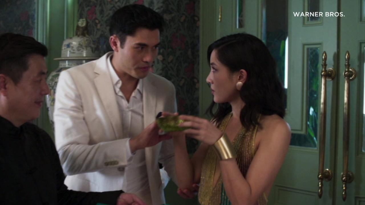 Constance Wu and Henry Golding are shown in a scene from the new movie Crazy Rich Asians.