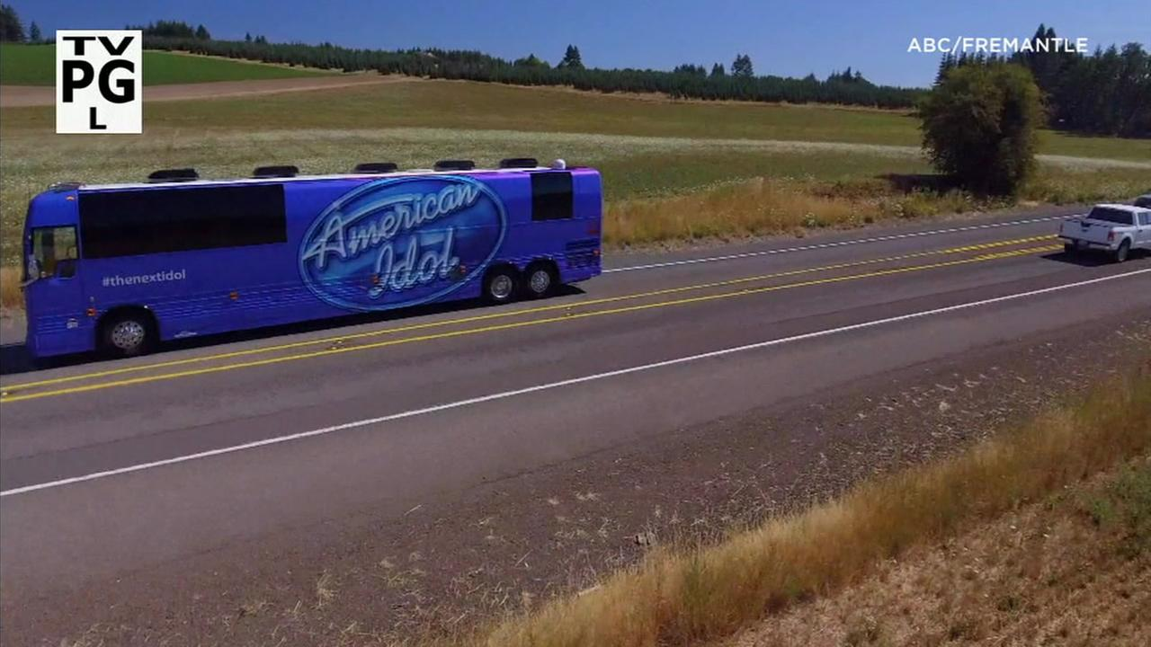 The American Idol bus is shown in footage.