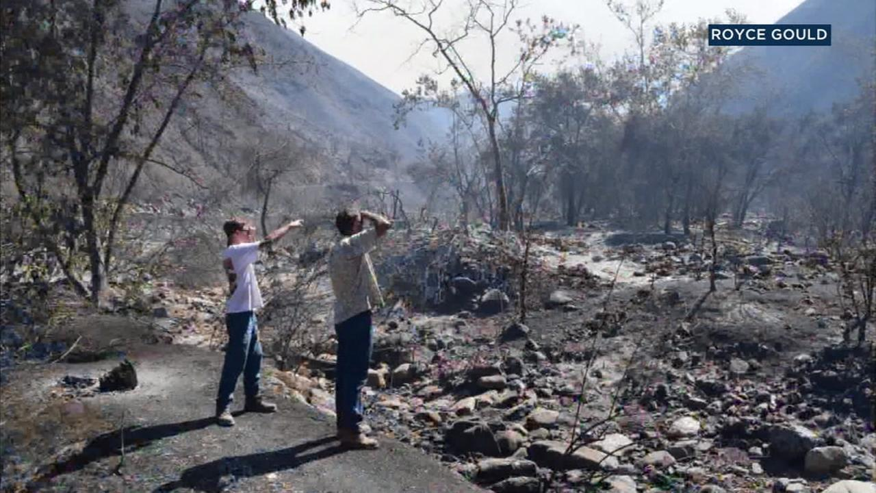 A witness captured the devastation left behind from the Holy Fire burning in Orange County near the Riverside County border.