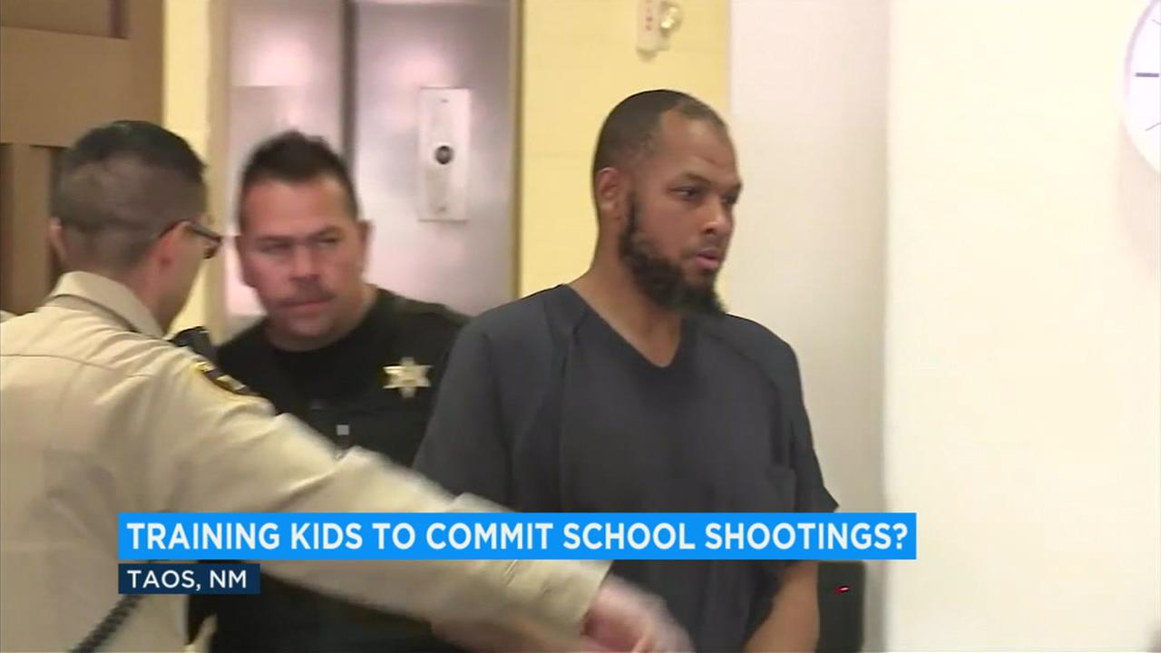 The father of a missing Georgia boy was training children at a New Mexico compound to commit school shootings, prosecutors said in court documents obtained Wednesday.