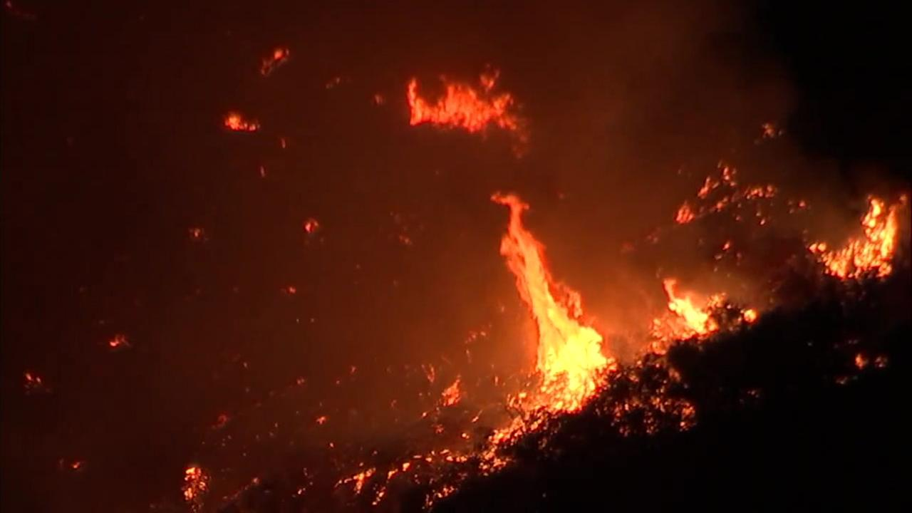 Flames eat up brush in the Cleveland National Forest near the Orange County and Riverside County border.