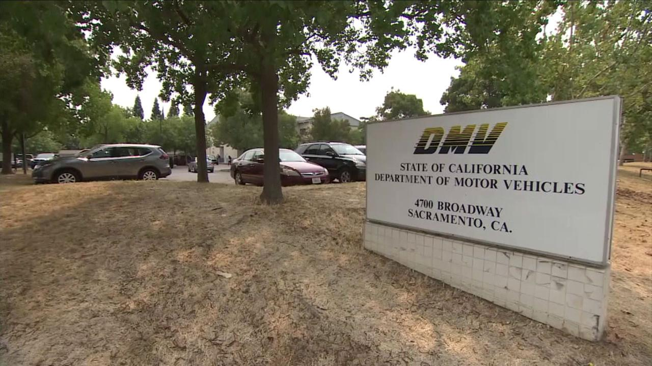 A sign for a DMV office in Sacramento is shown.