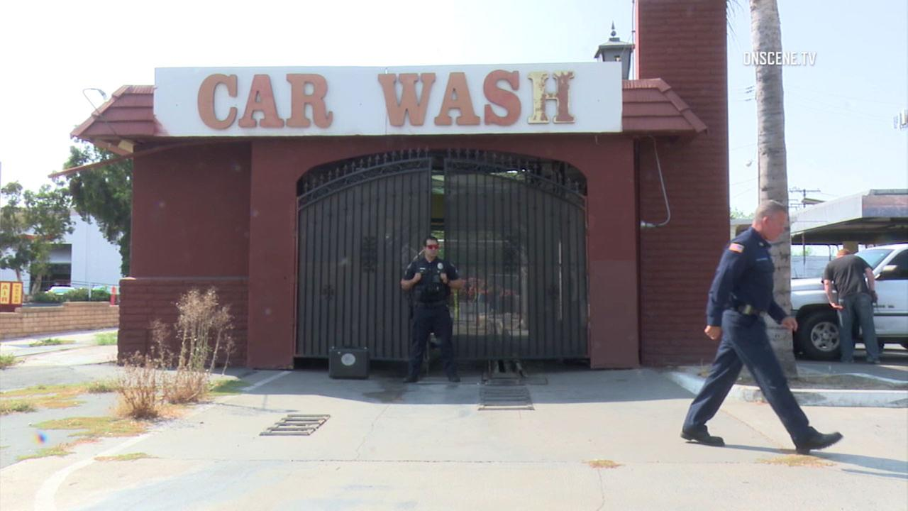Authorities at a vacant car wash in Tustin where a man was found dead on Saturday, Aug. 11, 2018.