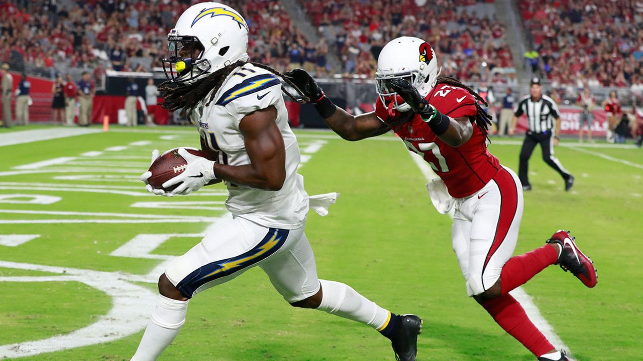Chargers wide receiver Geremy Davis scores a touchdown as Cardinals defensive back Chris Campbell defends during the second half of a preseason NFL football game Aug. 11, 2018.