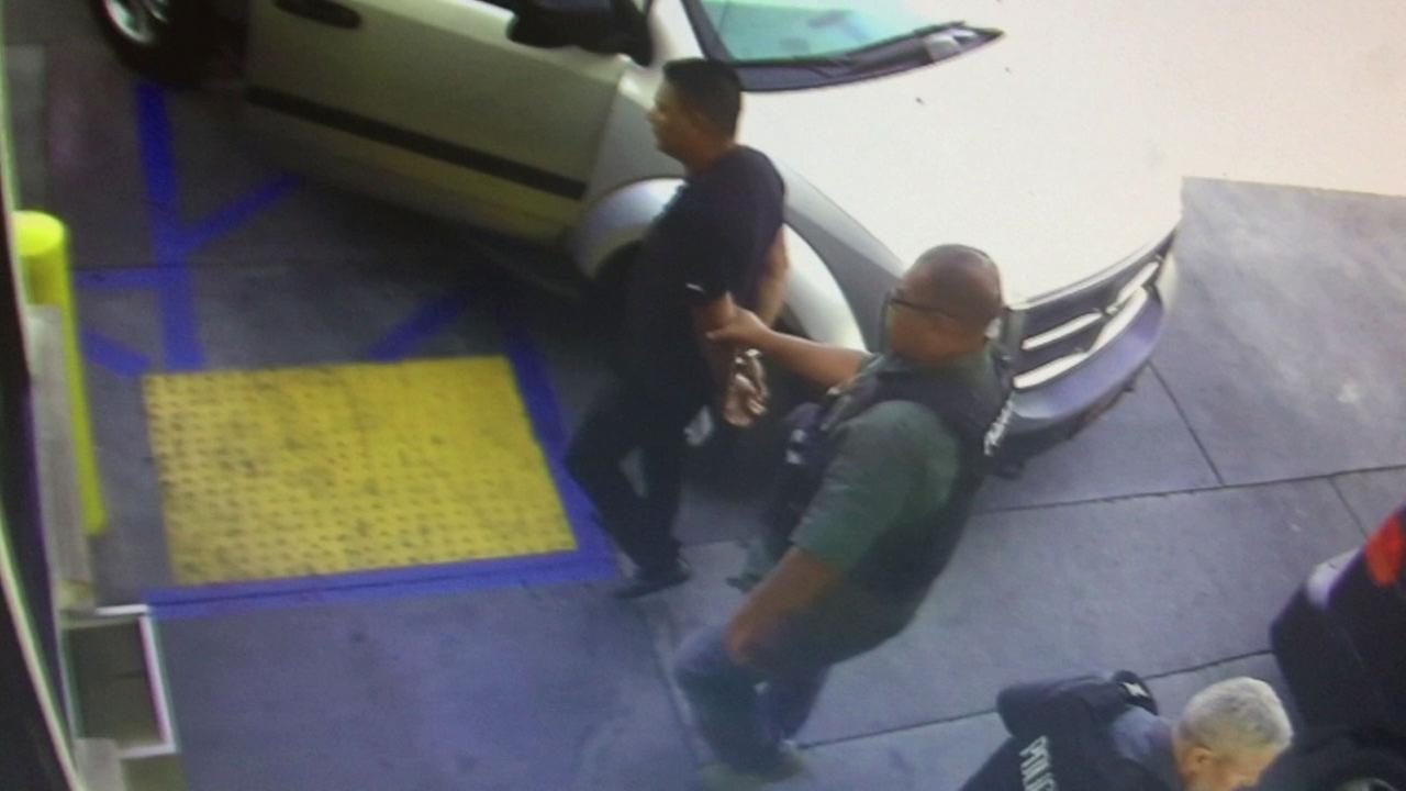 Surveillance video from a San Bernardino gas station shows ICE agents taking Joel Arrona-Lara, 36, into custody after stopping him for documentation.