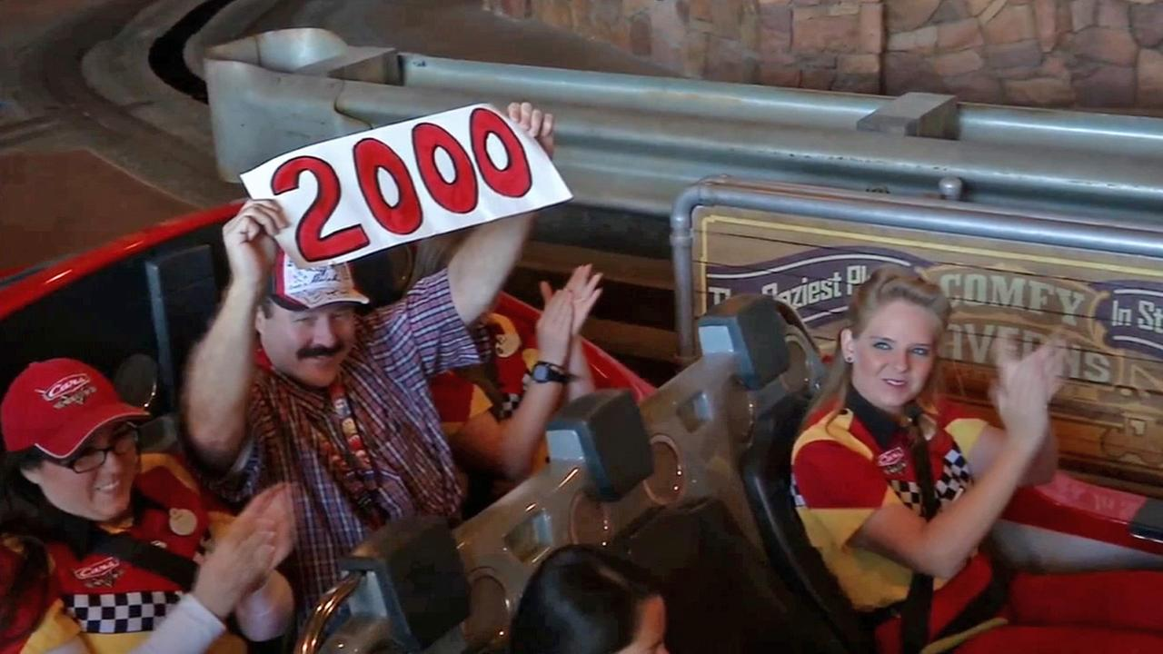 Jon Hale is seen at the end of his 2,000th ride on the Radiator Springs Racers on Monday, Nov. 17, 2014.