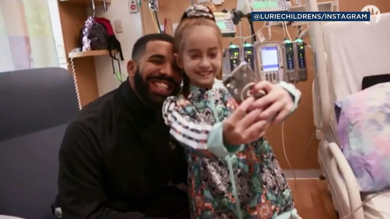 Rapper Drake and young heart patient Sofia Sanchez pose in a photo.