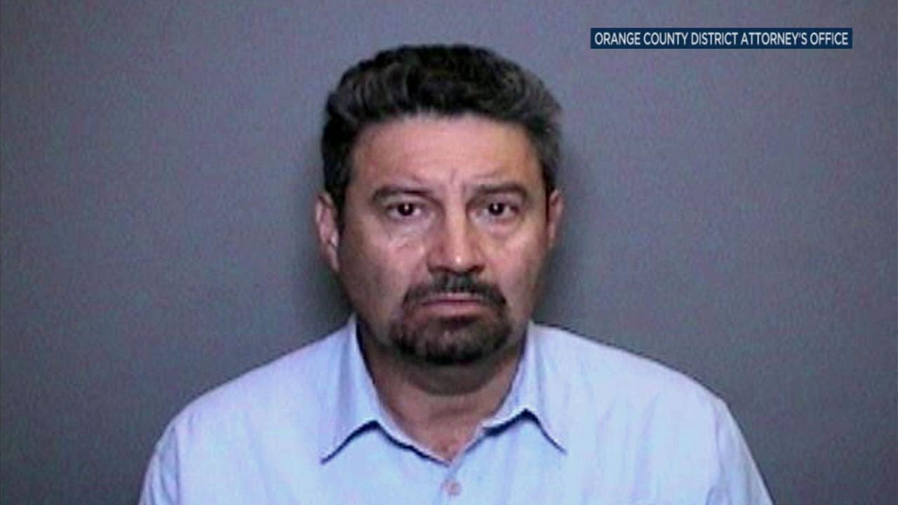 Dr. Carlos Montano is shown in a mugshot.