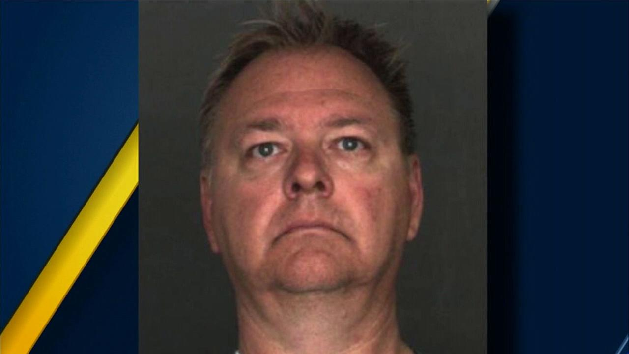 Charles Mayer, 55, is shown in a mugshot.