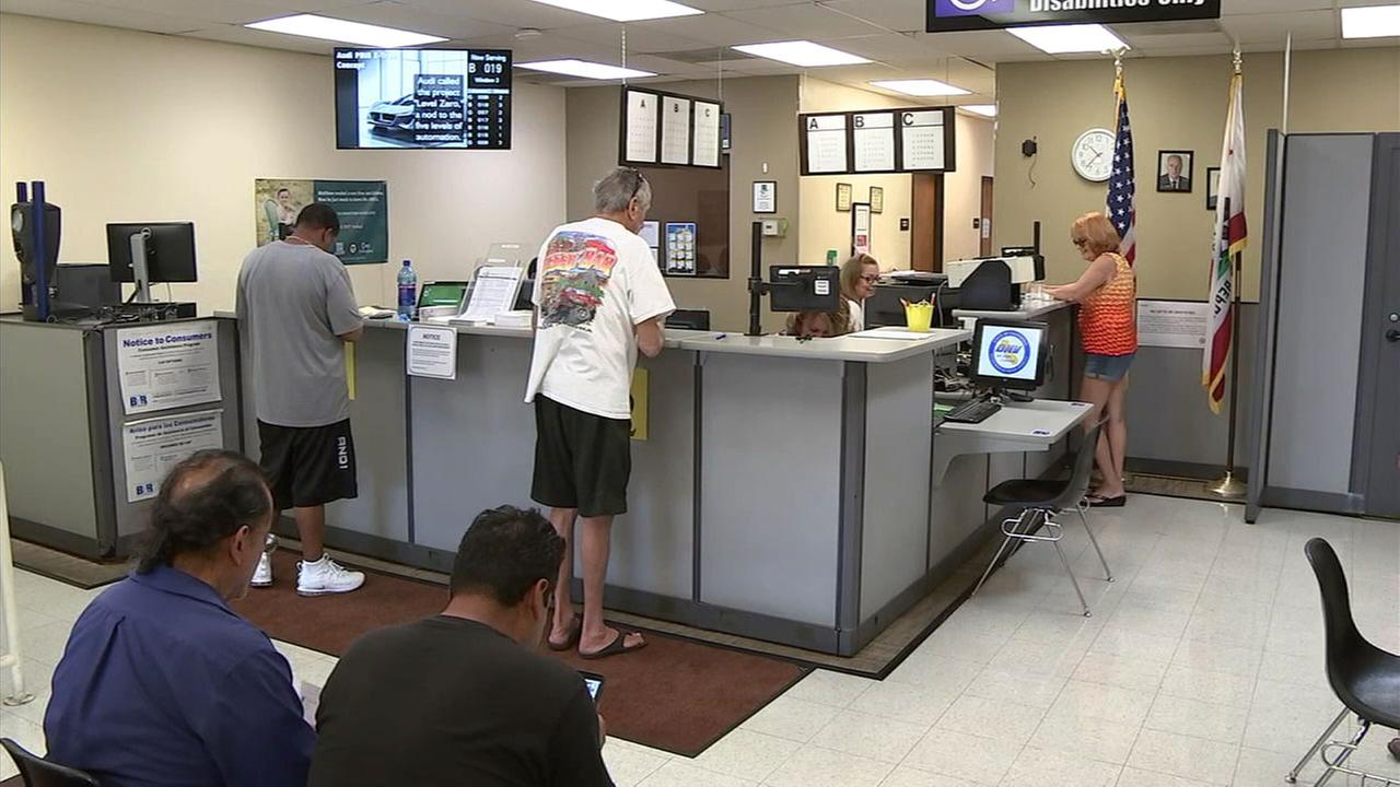 A short line of people wait for service at the DMV office in Needles, California, a town not far from the Arizona border.