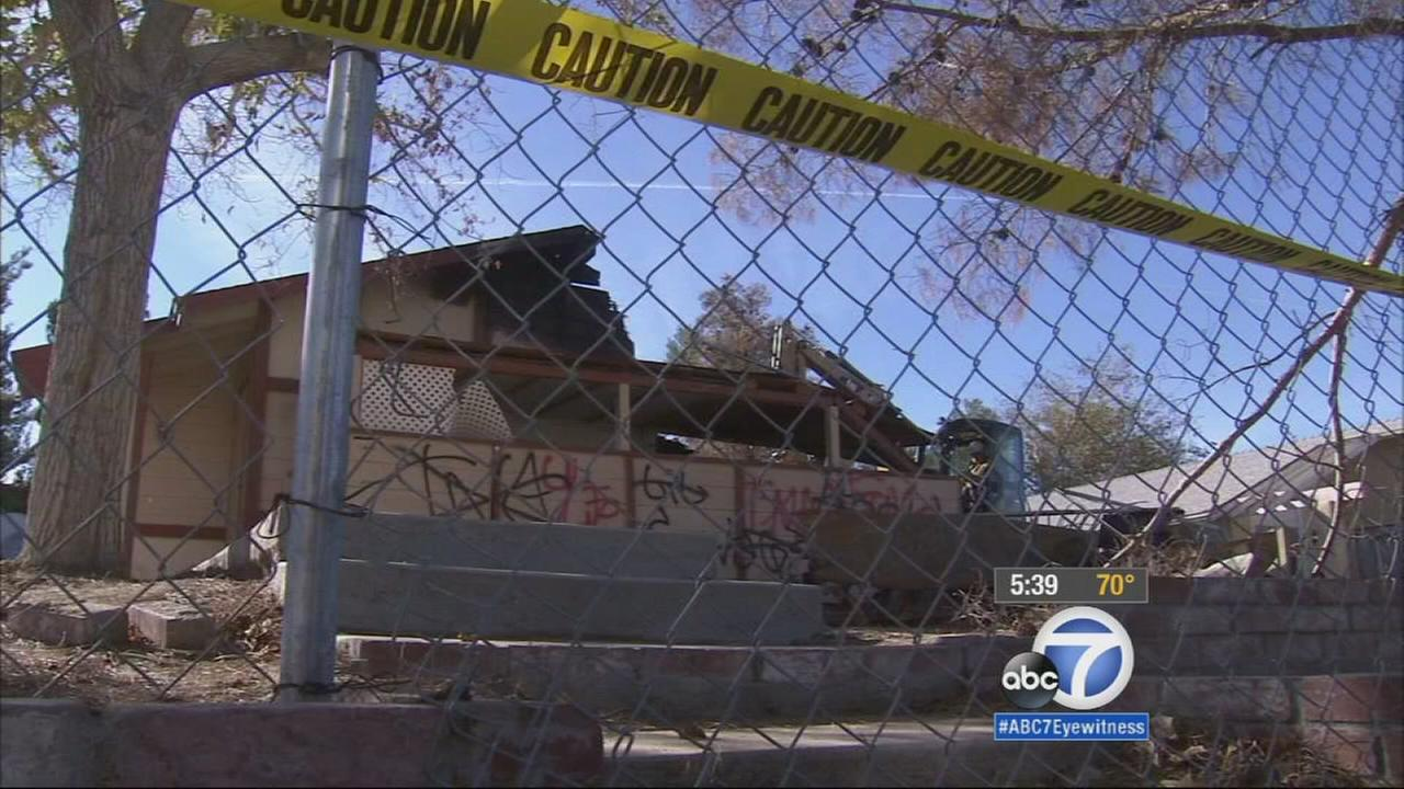 A foreclosed home in Victorville was demolished after five years of neighborhood complaints about parties and fires in the empty space.