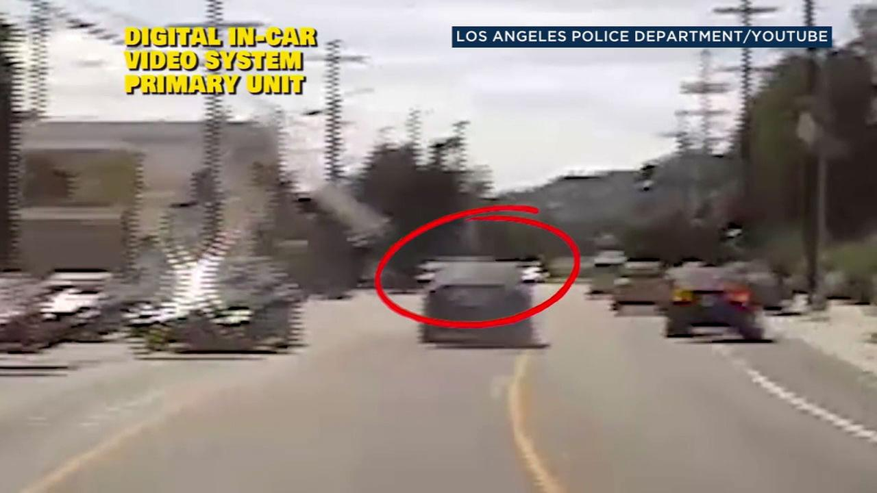 LAPD dashcam video shows a brief chase that came before a deadly standoff at a Trader Joes grocery store in Silver Lake on July, 21, 2018.