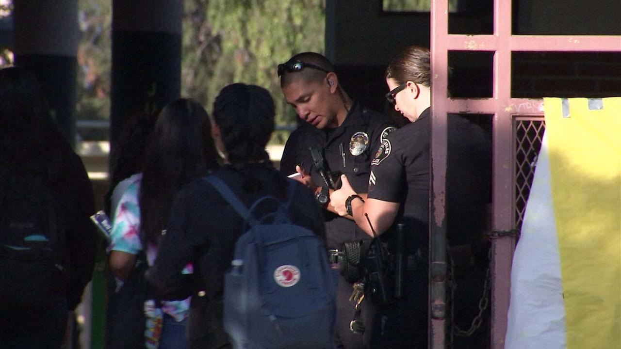 Police officers are seen at San Fernando High School in Pacoima following a social media threat that was deemed non credible by investigators.