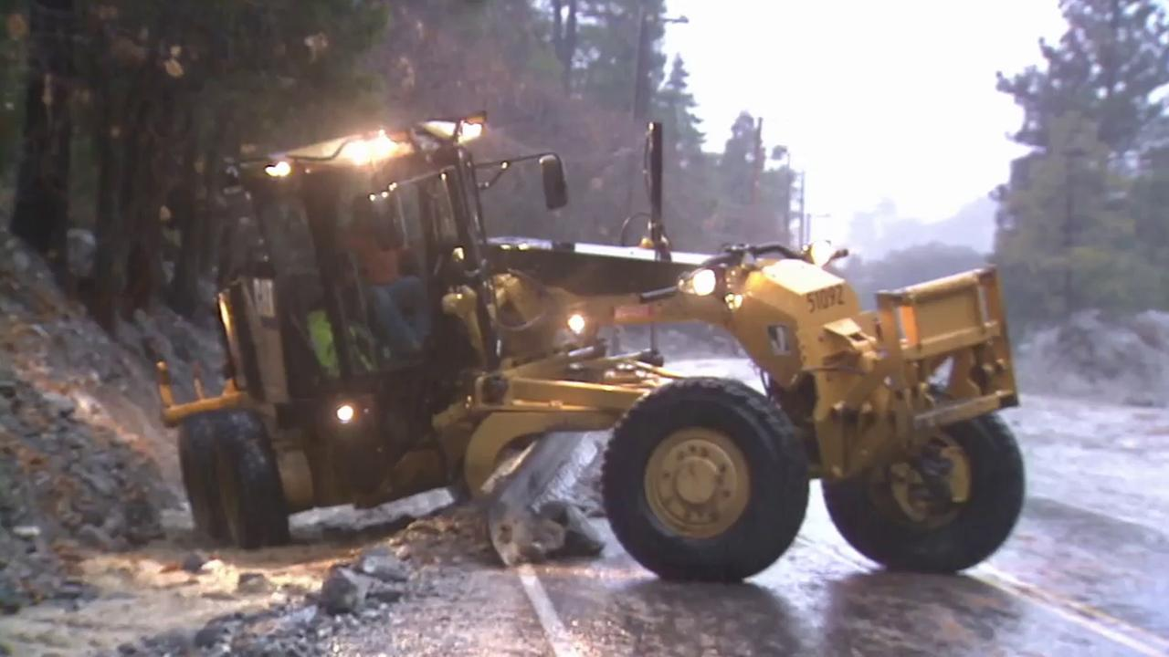 Crews clear debris and mud off the roadways in Forest Falls on Tuesday, Dec. 2, 2014.