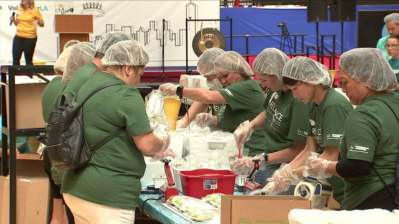 Volunteers put together meals for those in need in Los Angeles as part of a 9/11 Day Organization project.