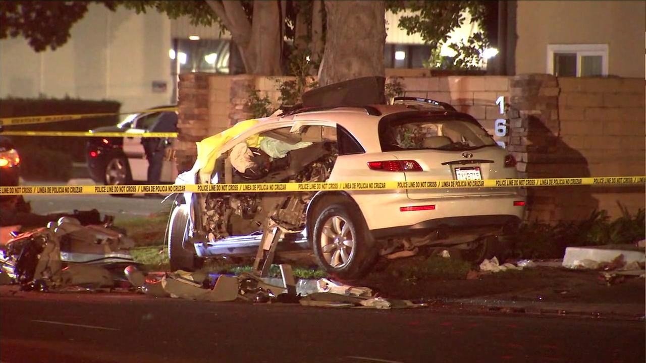 A burglary suspect was killed and two others were hospitalized after their SUV crashed at the end of a pursuit in Santa Ana.