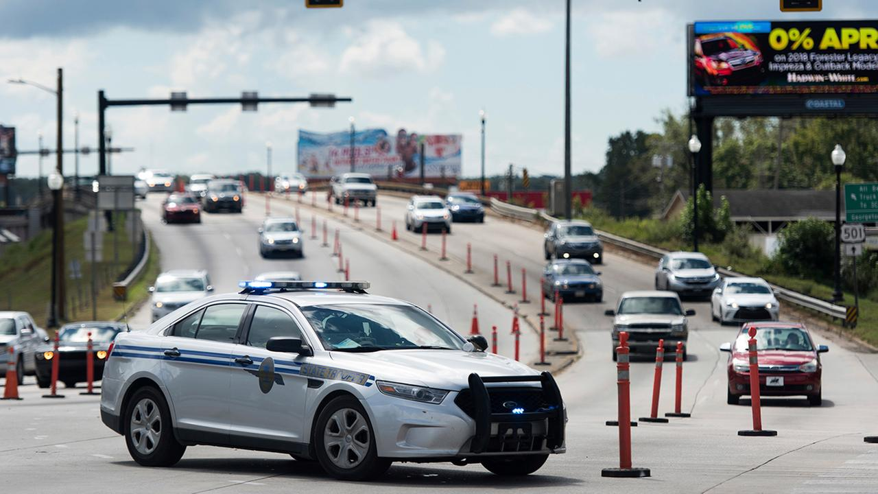 A South Carolina state trooper directs counterflow traffic traveling west from Myrtle Beach on U.S. 501 as Hurricane Florence approaches, Wednesday, Sept. 12, 2018, in Conway, S.C.