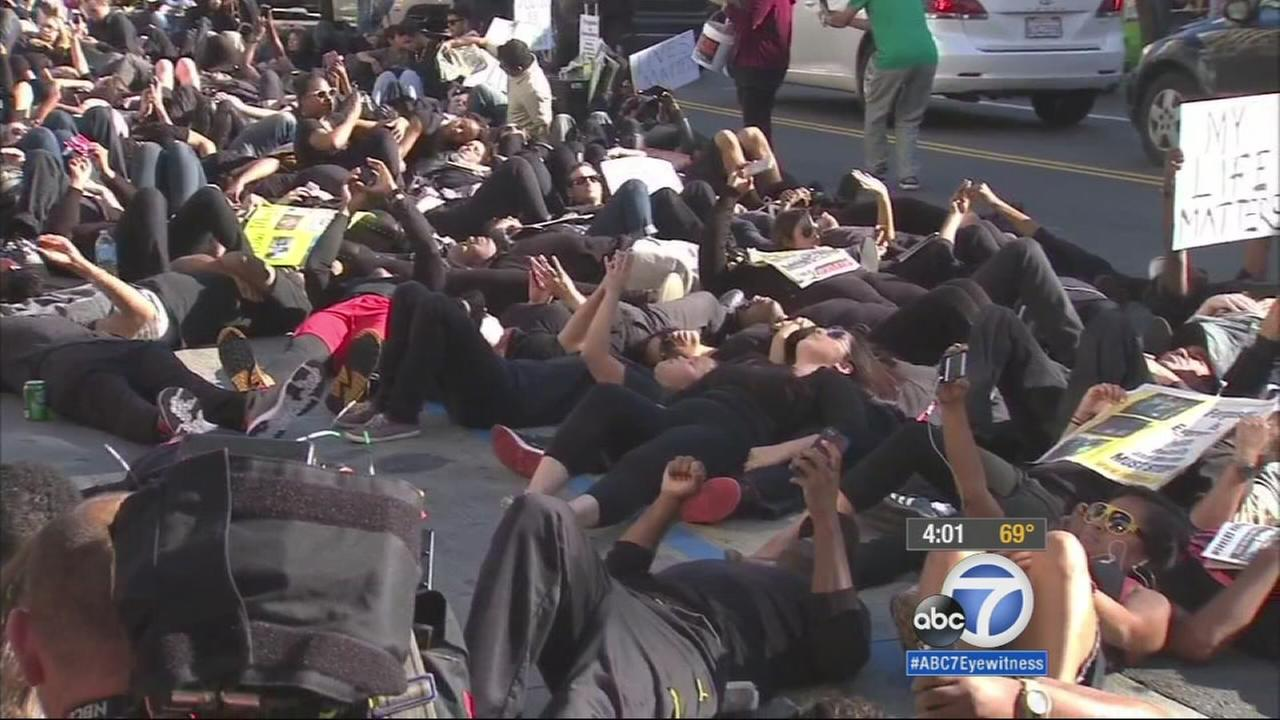 Protesters stage a die-in on Hollywood Boulevard near the Dolby Theatre on Saturday, Dec. 6, 2014.