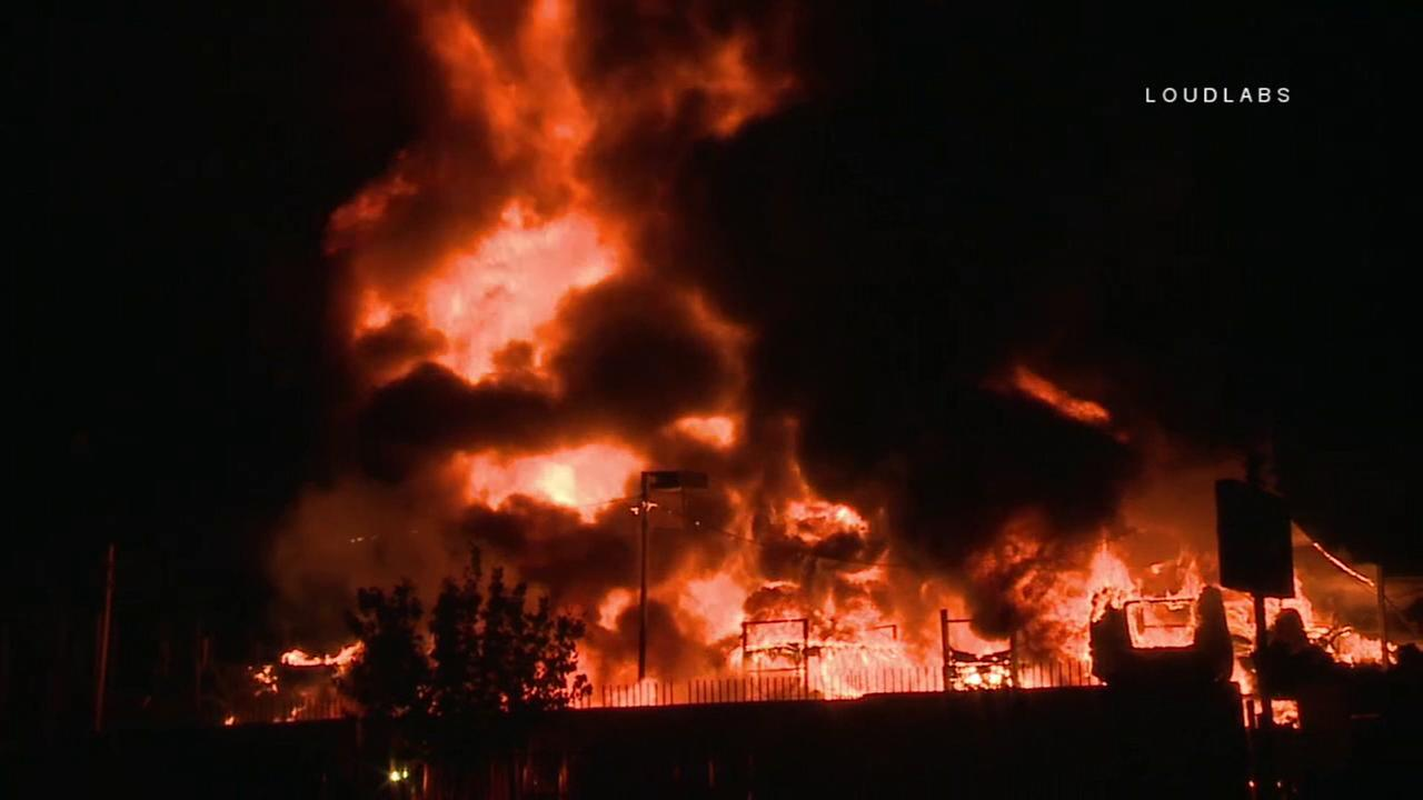Firefighters extinguished a dramatic fire that erupted Tuesday, Sept. 18, 2018, at an auto parts yard in Sun Valley, officials said.